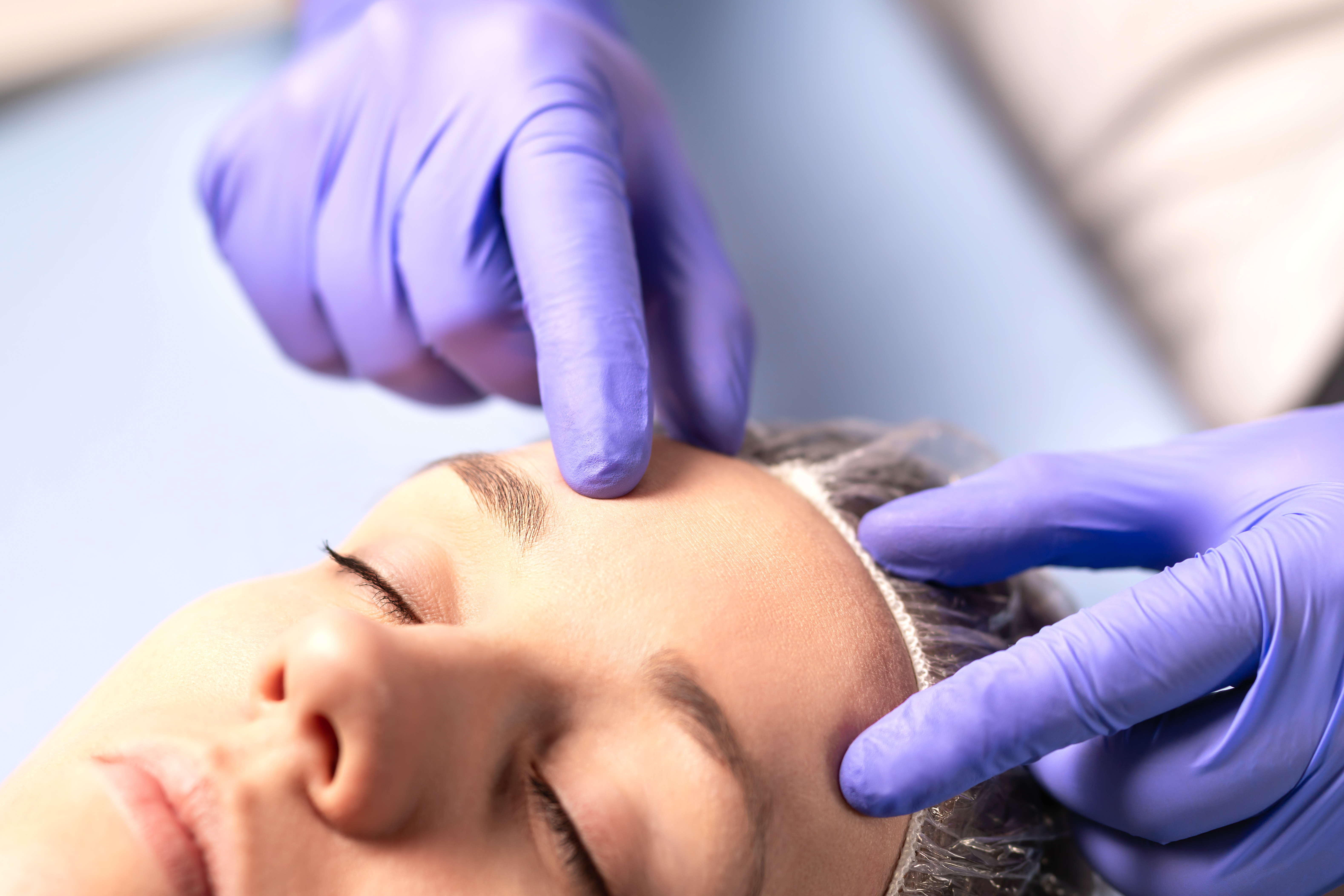 Cosmetologist, plastic surgeon or doctor with patient or customer. Consultation and plan before facial surgery in hospital, skin treatment or facelift in clinic. Professional skincare in beauty salon