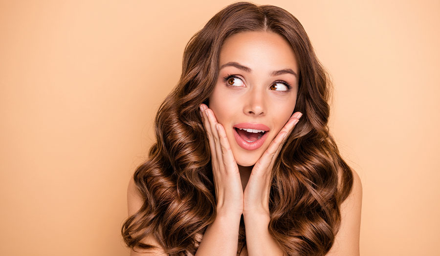 Close-up portrait of nice attractive lovely feminine sensual gorgeous cheerful cheery girlish wavy-haired girl enjoying expecting sale give away isolated on beige pastel color background