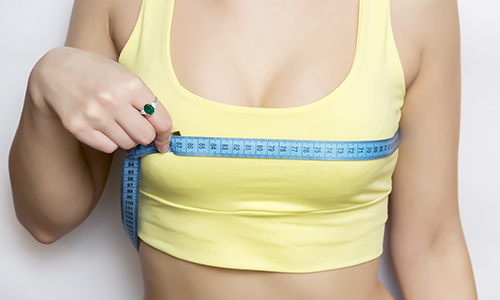 woman-measuring-breasts